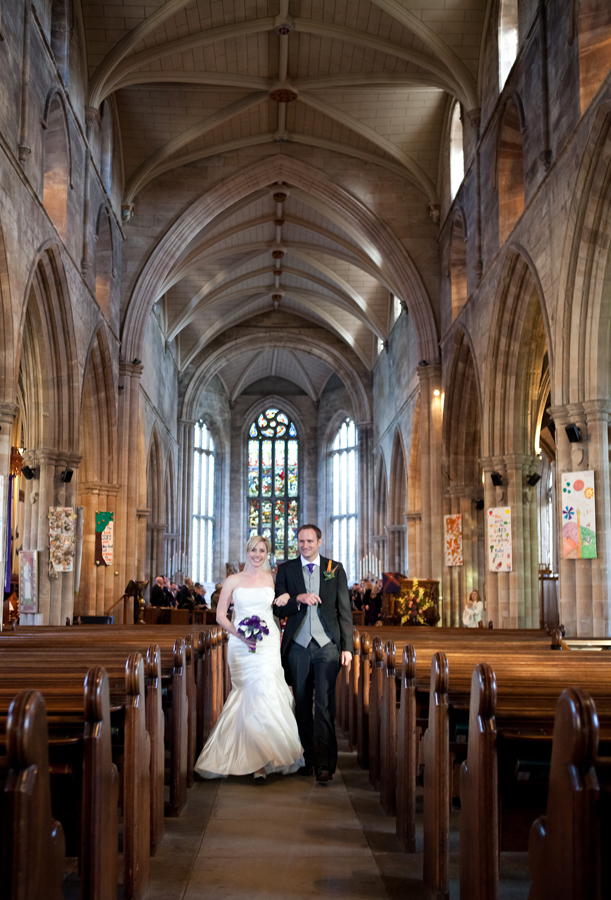 Bride and groom leaving the wedding ceremony at St. Michaels' Parish in Linlithgow