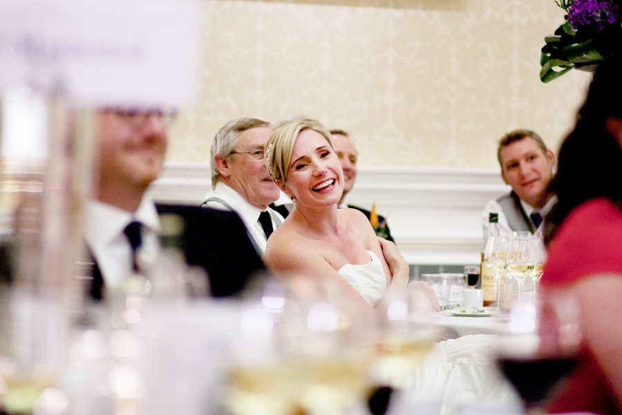 Bride laughing during specches at Merchant's Hall in Edinburgh