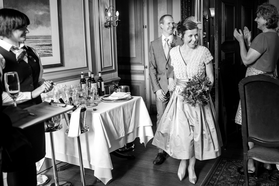 Bride and groom entering the reception room at Cringletie House wedding celebrations