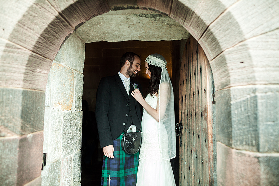 Married couple at Edinburgh Castle after the wedding ceremony