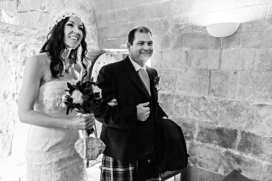 Bride walking with her father to the groom at Edinburgh castle wedding ceremony