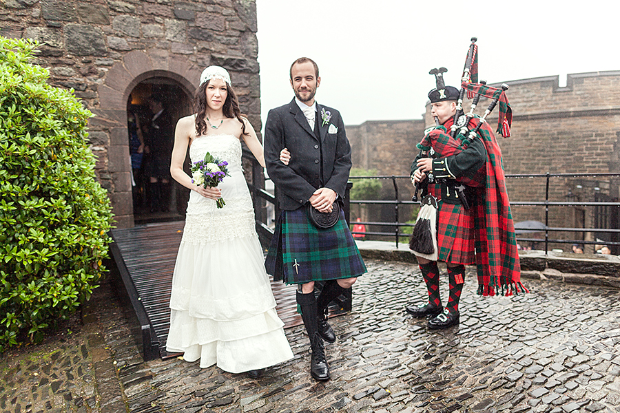 Happy couple leaving the chapel at Edinburgh Castle