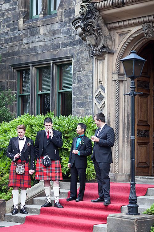 Groom-and-his-groomsmen-smoking-cigars