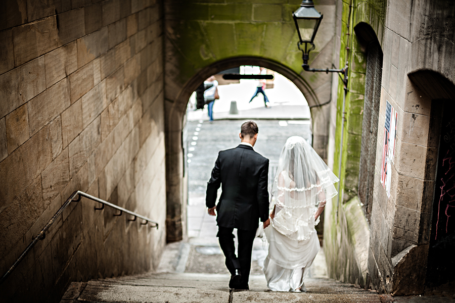 Bride and groom in one of the Royal Mile closes