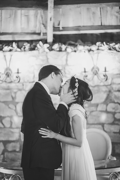 Bride and groom kiss at Harburn House wedding ceremony