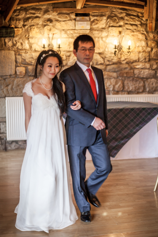The father gives a way to his daughter at Harburn House wedding ceremony