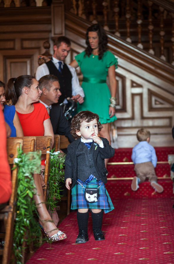 Cute page boy in kilt before the wedding ceremony at Dalhousie Castle