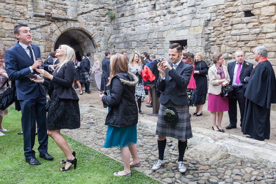Wedding guests having fun on Inchcolm Island during the wedding photography