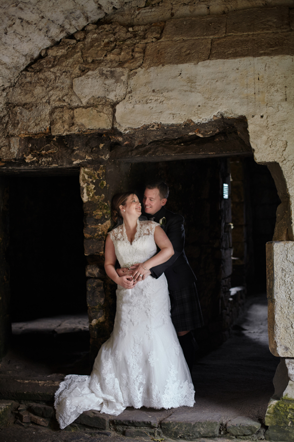 Romantic portraits of bride and groom on Inchcolm Island during wedding