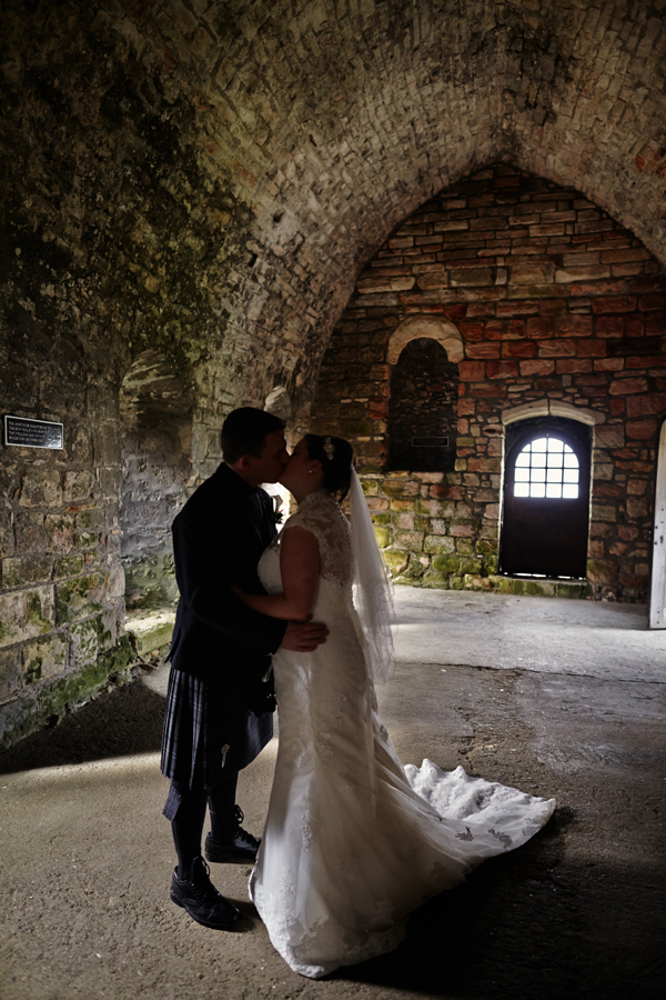 Malishka Photography capturing the married couple on Inchcolm Island at their wedding