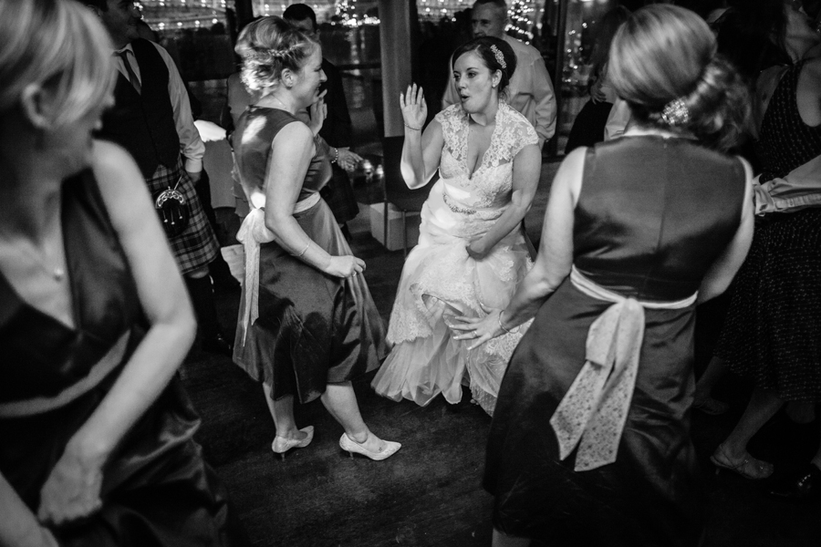 Bride and her bridesmaids having fun on the dance floor at Orocco Pier