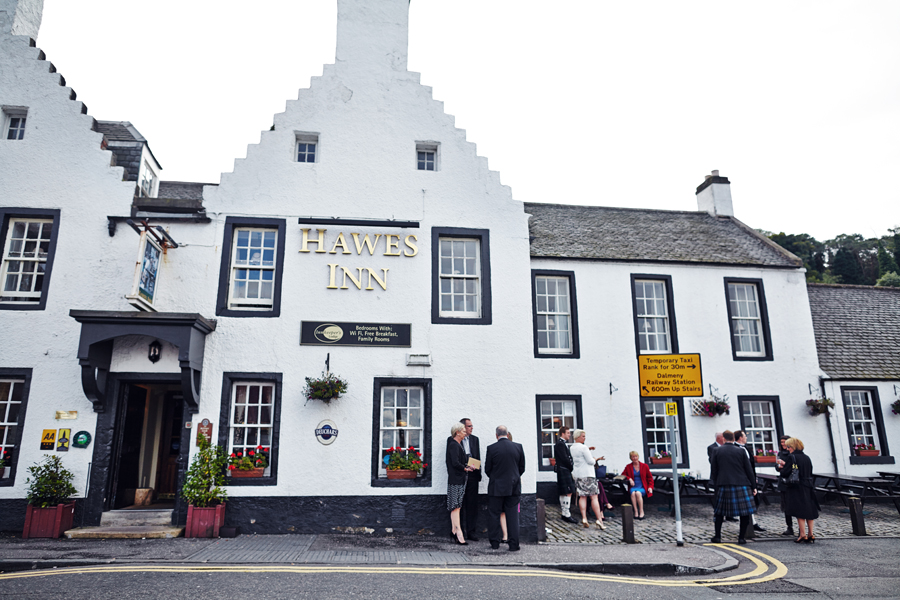 Guests gathering at Hawes Inn in South Queensferry before the wedding ceremony