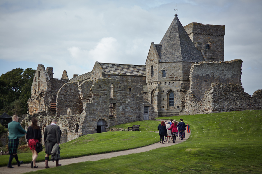 Wedding guests walking to Inchcolm Abbey