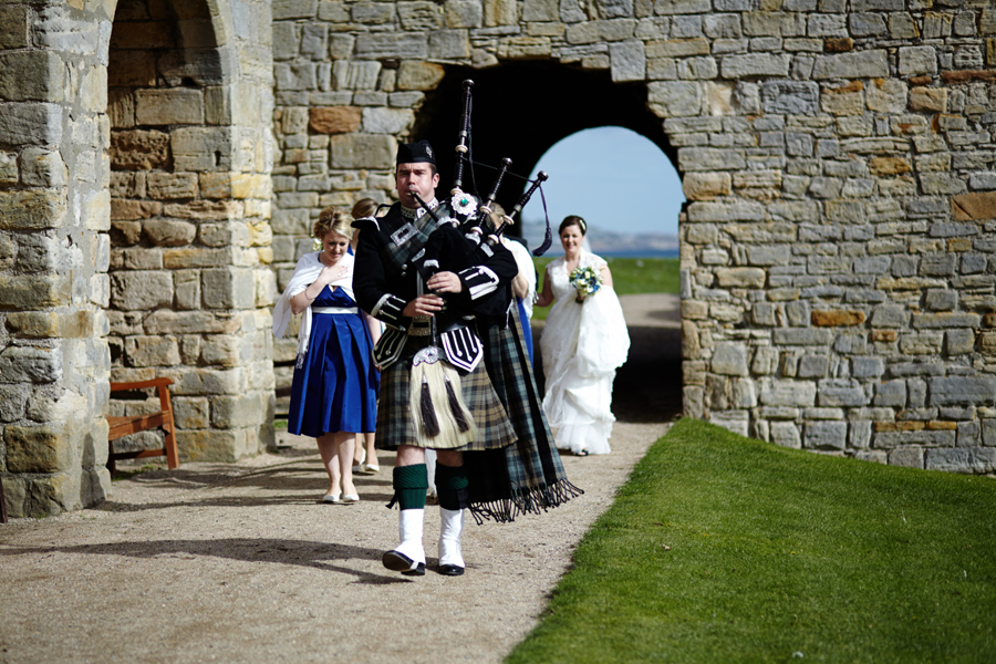 Piper leading the bride at Inchcolm Island wedding