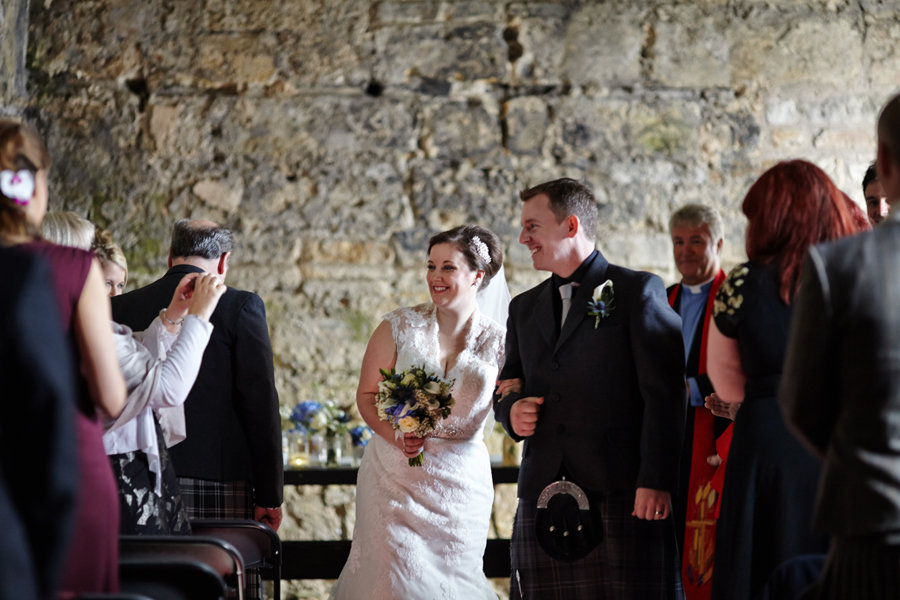 Happy bride and groom at Inchcolm Island wedding ceremony