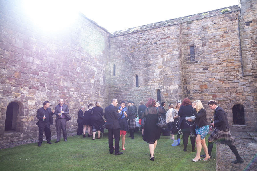 Guests mingling on Inchcolm Island during the wedding drinks