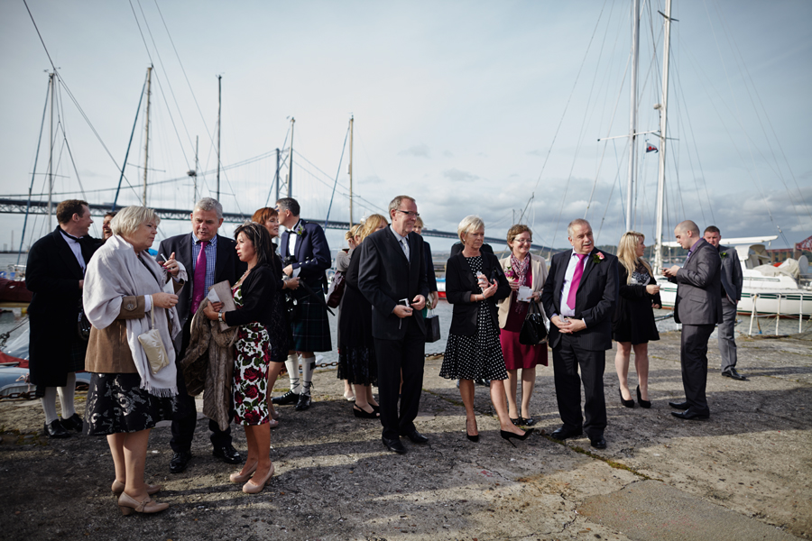 Wedding guests waiting for the couple at Orocco Pier in South Queensferry