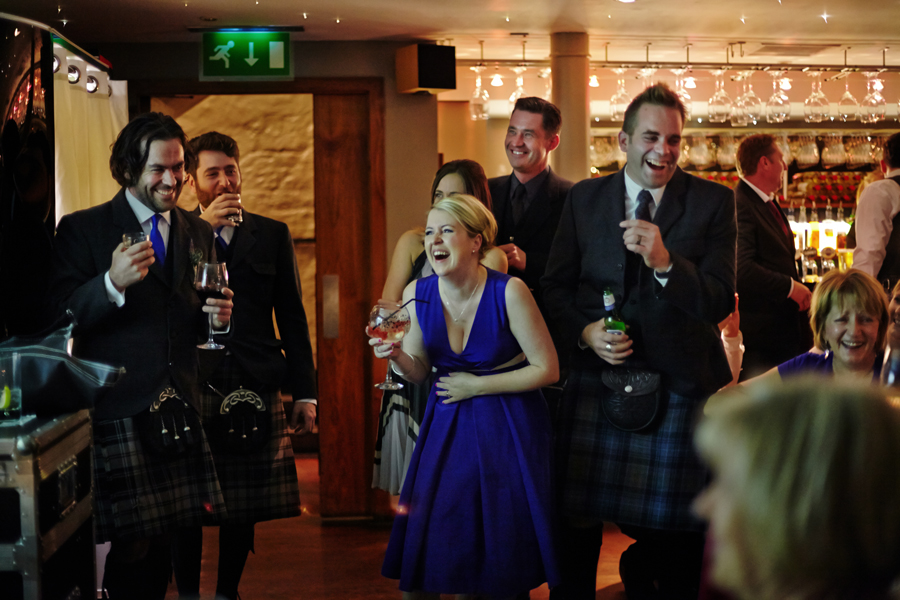 Wedding guests having fun during wedding reception at Orocco Pier in South Queensferry