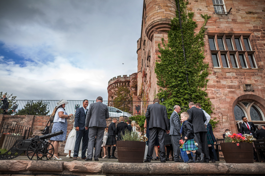 Wedding guests at the balcony of Dalhousie Castle