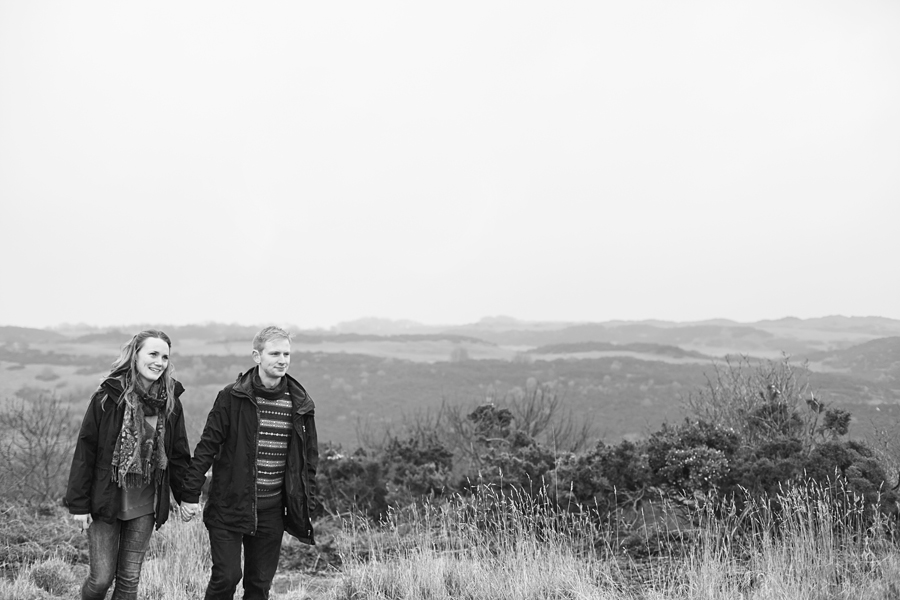 A couple on a romantic walk at Blackford Hill in Edinburgh during a photo session
