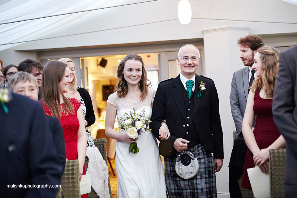 Bride and her father during the wedding ceremony at Bruntsfield Hotel in Edinburgh