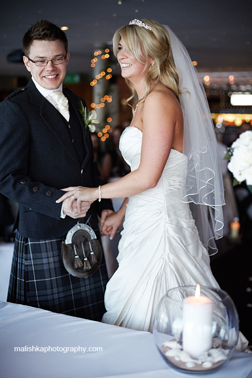 Happy couple at the wedding ceremony in South Queensferry