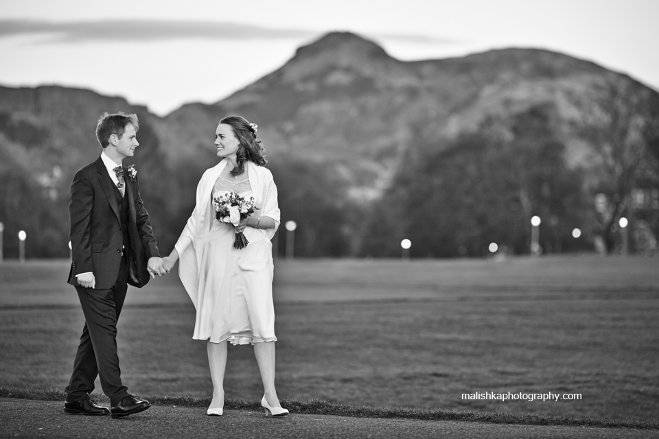 Bride and groom walking in the Links