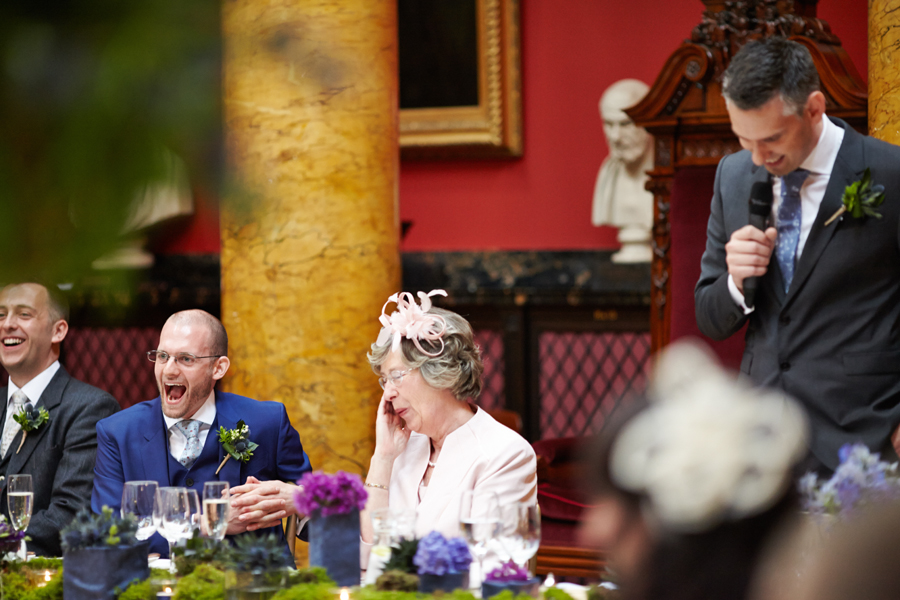 Laughing couple during the speeches at Royal College of Physicians in Edinburgh