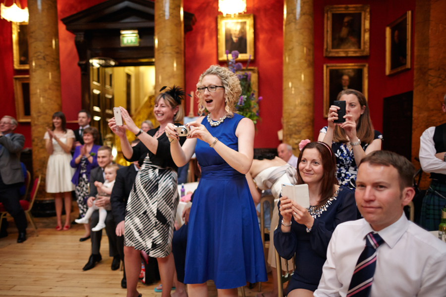 Cheering wedding guests during the first dance at Royal College of Physicians in Edinburgh