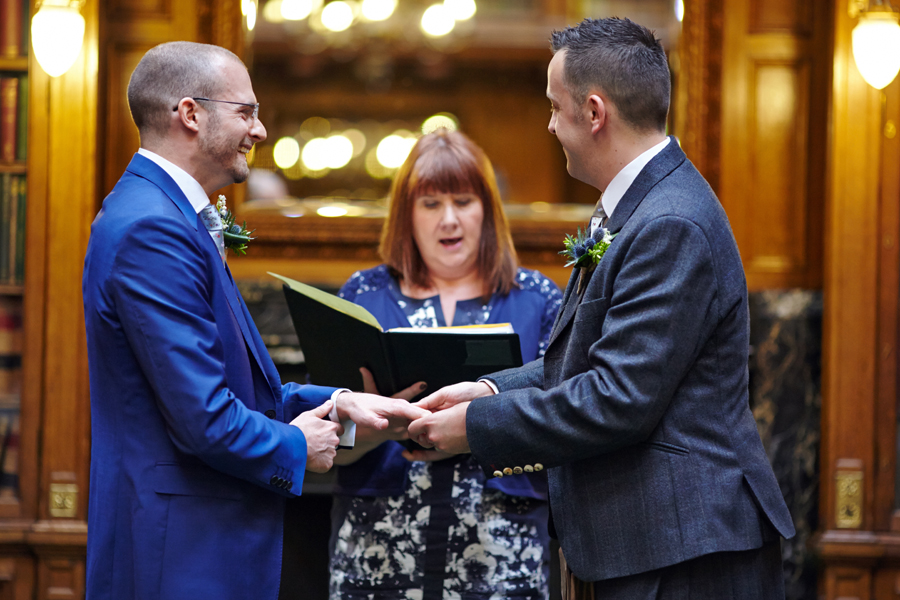 Happy moments during civil partnership ceremony at Royal College of Physicians in Edinburgh