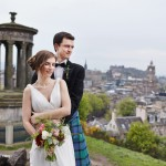 Photos of bride and groom at Calton Hill with the views at Edinburgh