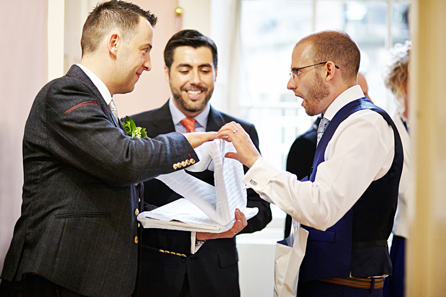 Surprised couple  at civil partnership at Royal College of Physicians in Edinburgh