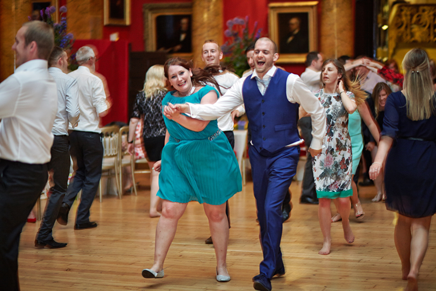 Photos of dancing wedding quests at civil partnership at Royal College of Physicians in Edinburgh