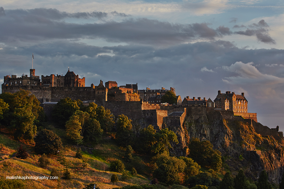 Edinburgh Castle illuminated by the light of setting sun