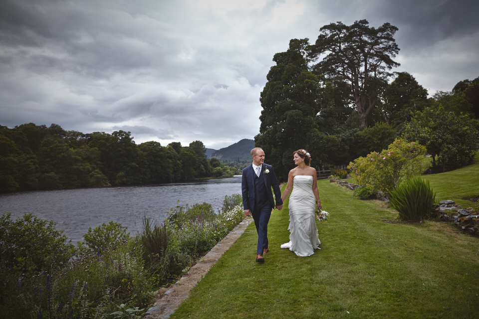 Bride & Groom walking along the river Tay