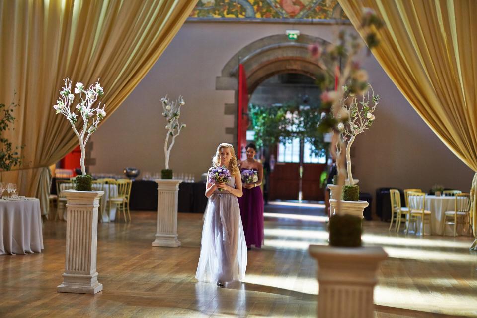 Bridesmaids walking at Mansfield Traquair at wedding ceremony
