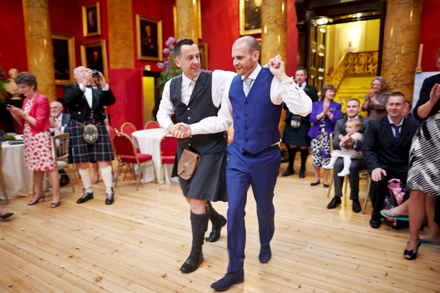 Same-sex couple dancing their first dance at civil partnership at Royal College of Physicians in Edinburgh