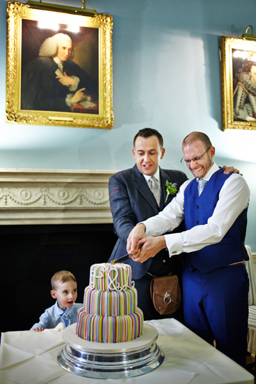Couple cutting the wedding cake at civil partnership at Royal College of Physicians in Edinburgh