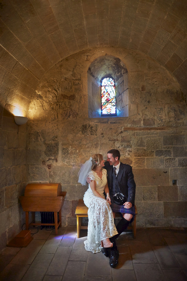 Bride and groom at the Edinburgh Castle Chapel
