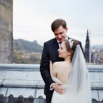 Bride and groom on the roof of the Balmoral Hotel Edinburgh