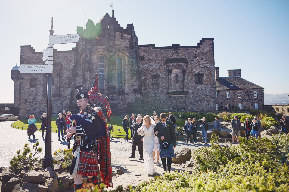 Bride and piper arriving at Edinburgh Castle wedding